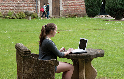 [student working outside at the Castle]