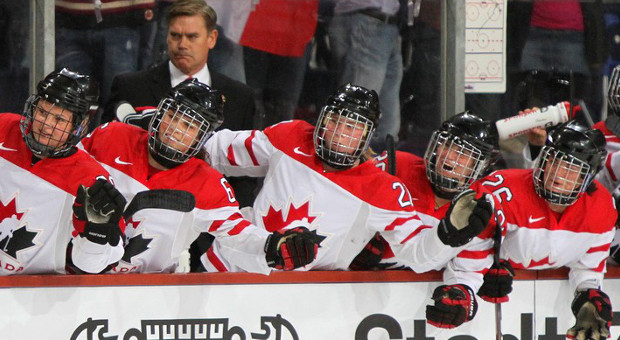 Team Canada Women's Hockey Team celebrating after a goal.