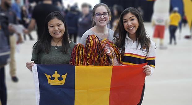 Queen's volunteers with flag