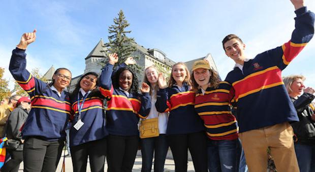 Queen's Young Alumni in Tricolour cheering