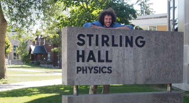 [Student in front of Stirling Hall sign]