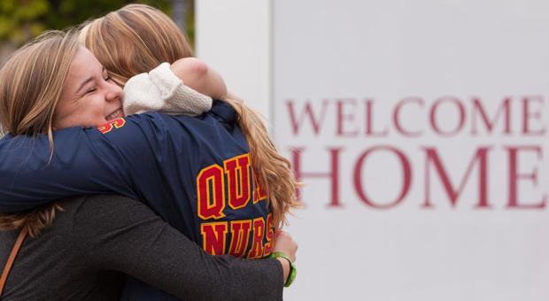 homecoming reunion hug