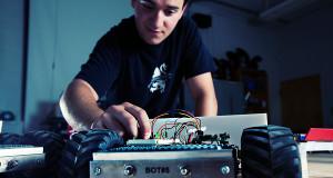 [Student using mechanical lab equipment]