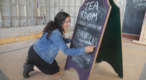 Isabel Hazan updates the sign.