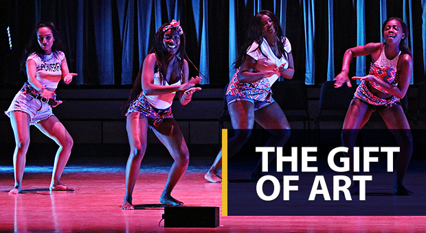 The Gift of Art: A photo of performers on stage at the Isabel Bader Centre for Performing Arts