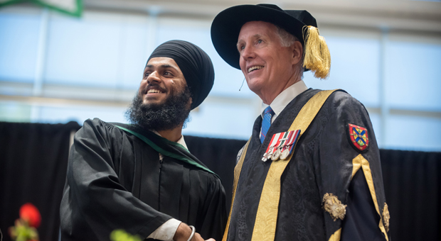 Chancellor Jim Leech at Convocation with graduate