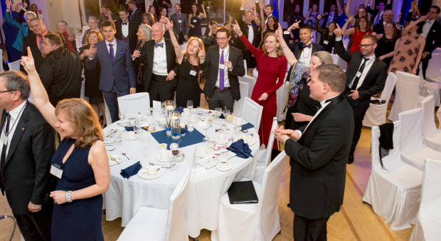 Gala attendees sing the Oil Thigh