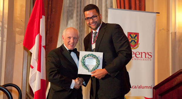 [Photo of Zhaodi Culbreath presenting the John Orr Award to John Rae]