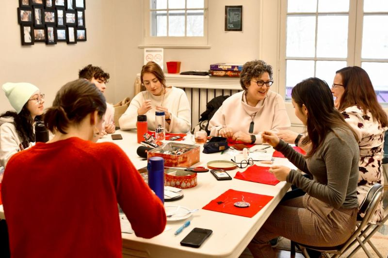 Karen Lawford (third from right) leading a weekly beadwork class at Queen's University's Four Directions Indigenous Student Centre.