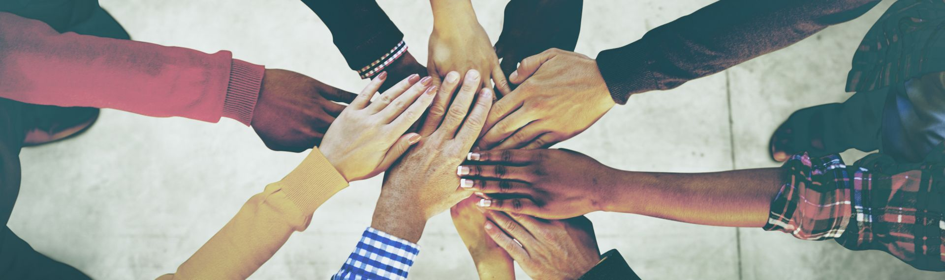 A diverse group of hands stacked on top of each other