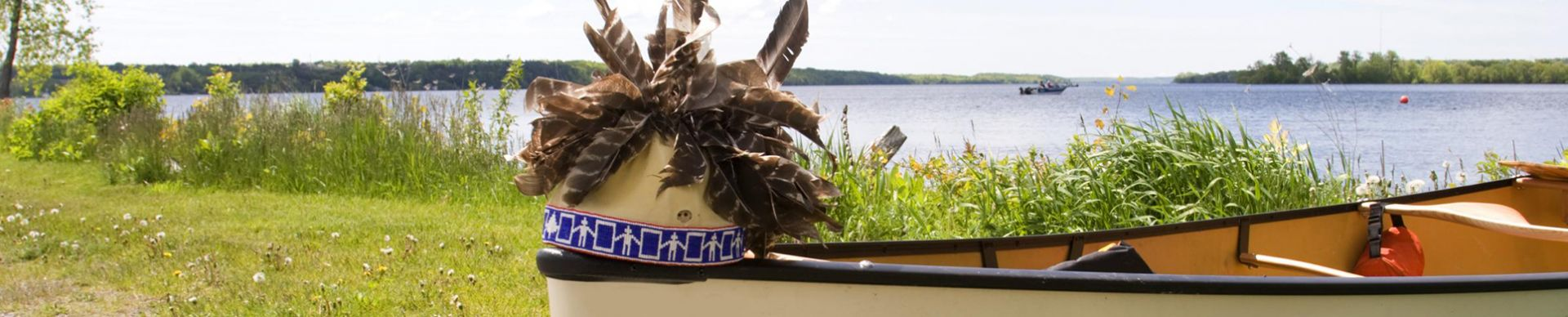 canoe with Mohawk headdress