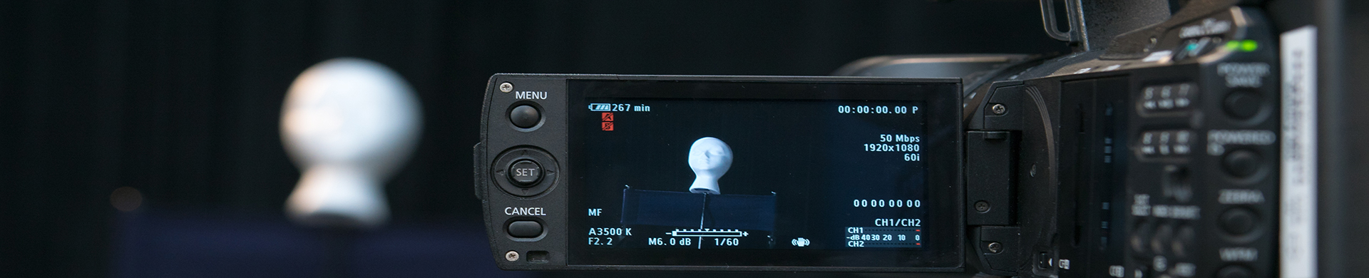 video camera filming a white mannequin head