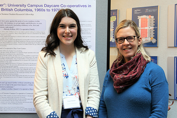 USSRF recipient Clare Simon takes a moment in front of her 2019 poster presentation with her faculty supervisor Dr. Lisa Pasolli.