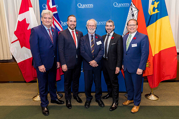 Principal and Vice-Chancellor Patrick Deane, centre, is joined by, from left, Interim Liberal Party leader John Fraser, Kingston and the Islands MPP Ian Arthur, Minister of Colleges and Universities Ross Romano, and Green Party leader Mike Schreiner.