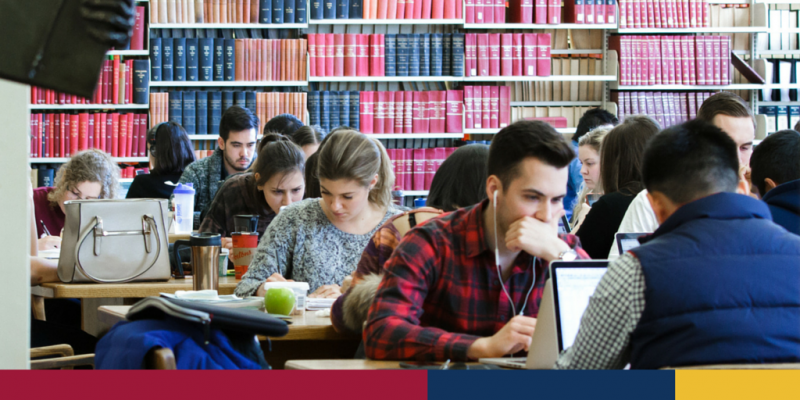 Photograph of students at Queen's University studying for exams in the library.
