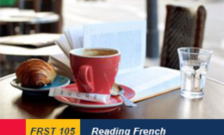 Image of a Breakfast in a Parisian street cafe - cup of coffee, croissant and book