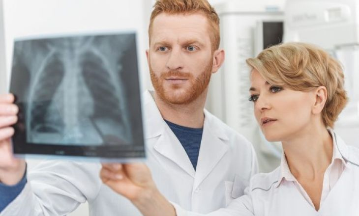 Two doctors examining an xray