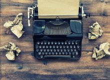 Typewriter and crumpled up papers