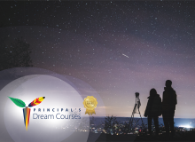 Two silhouettes examining a starry night sky