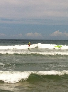 I caught the wave but my friend's ride didn't quite pan out (yellow surf board, middle-right)