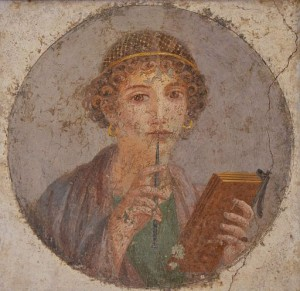 Fresco_showing_a_woman_so-called_Sappho_holding_writing_implements