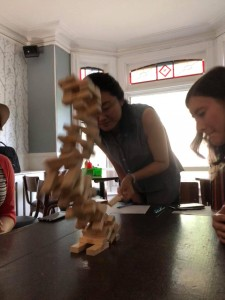 An SGPS member the moment she tragically loses at Jenga during one of the Grad Club Board Game nights