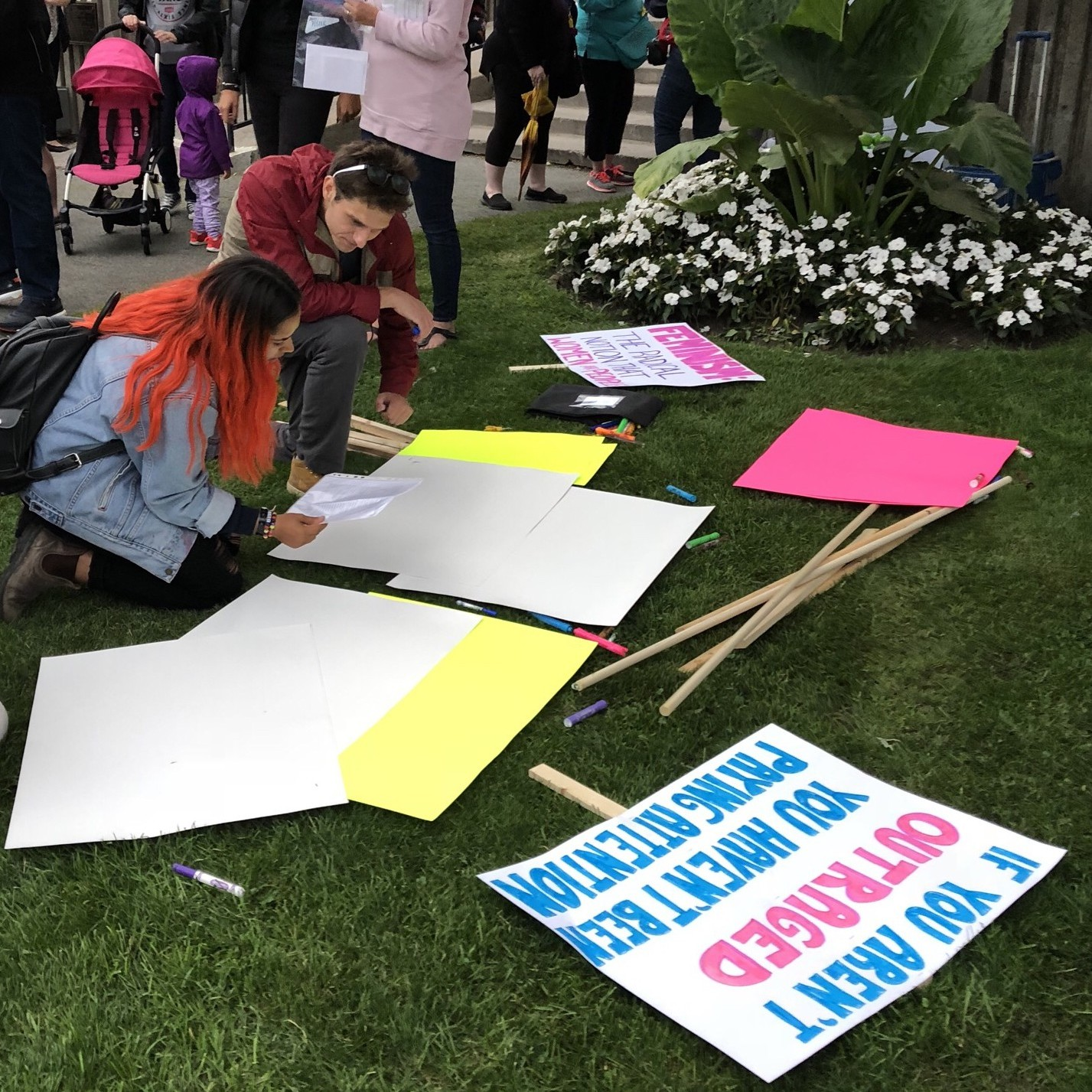 Participants make their signs for the March