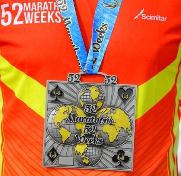 The custom medal for the 52 in 52 Challenge.