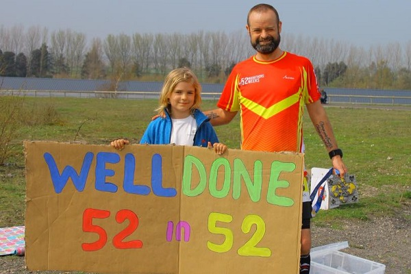 Adrian Thomas and his son pose after his fifty-second marathon in 52 weeks.