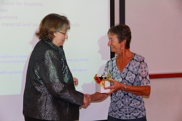 Joan Almost receives a token of appreciation for her efforts as a graduate coordinator.