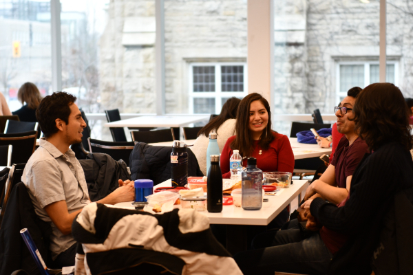 Students enjoying lunch in the new Queen's University International Centre at Mitchell Hall.