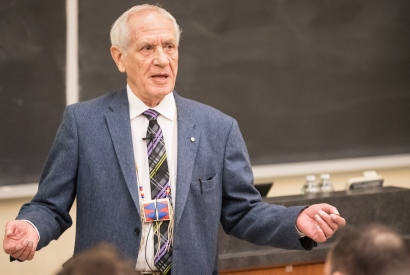 Douglas Cardinal lectures in front of a packed room in Macdonald Hall during his visit to Queen's to receive his honorary degree in March, 2017.