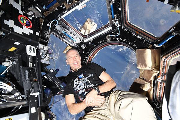 Astronaut and alumnus Andrew Feustel (PhD'95) poses above the Earth. (Photo: @Andrew_Feustel on Twitter)