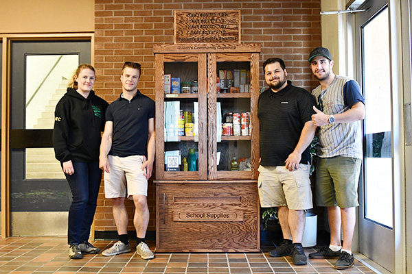 [A team of technological education students create a space at Duncan McArthur Hall to share and pick up non-perishable food items.]