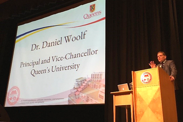 [Principal Woolf gives speech at the Canadian International School (Photo: Liz Gorman)]