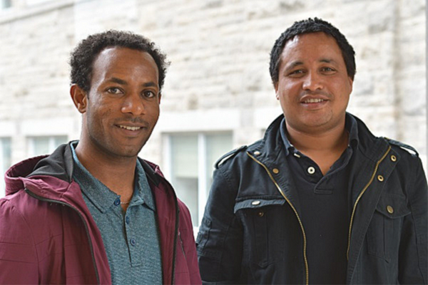 Mulugeta Chala (left) and Molalign Adugna (right), doctoral students in the School of Rehabilitation Therapy, will return to Ethiopia for a year of data collection in the fall after their first year at Queen's. (Photo: University Communications)