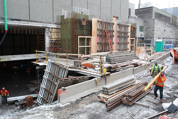 Crews are working to have the construction site fully enclosed by the holiday break. (Photo by Bernard Clark)