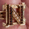 A 1934 Queen's Meds fraternity pin that has been made into a ring
