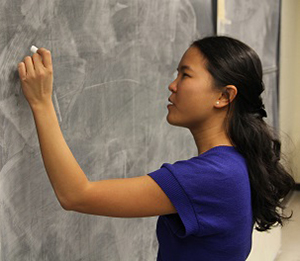 Dr. Magpantay writes on a blackboard in Jeffery Hall