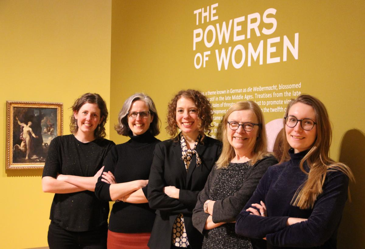 "Five members of the Agnes Etherington Art Centre team, including Director Jan Allen (second from right), pose in the ""Powers of Women"" exhibit. (University Communications)"