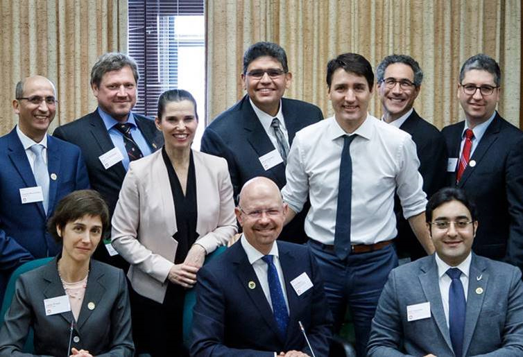 [Ahmed Hassan with Minister Kirsty Duncan and Prime Minister Justin Trudeau]