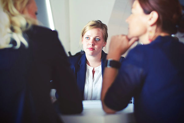 Woman CEO listens to two other women