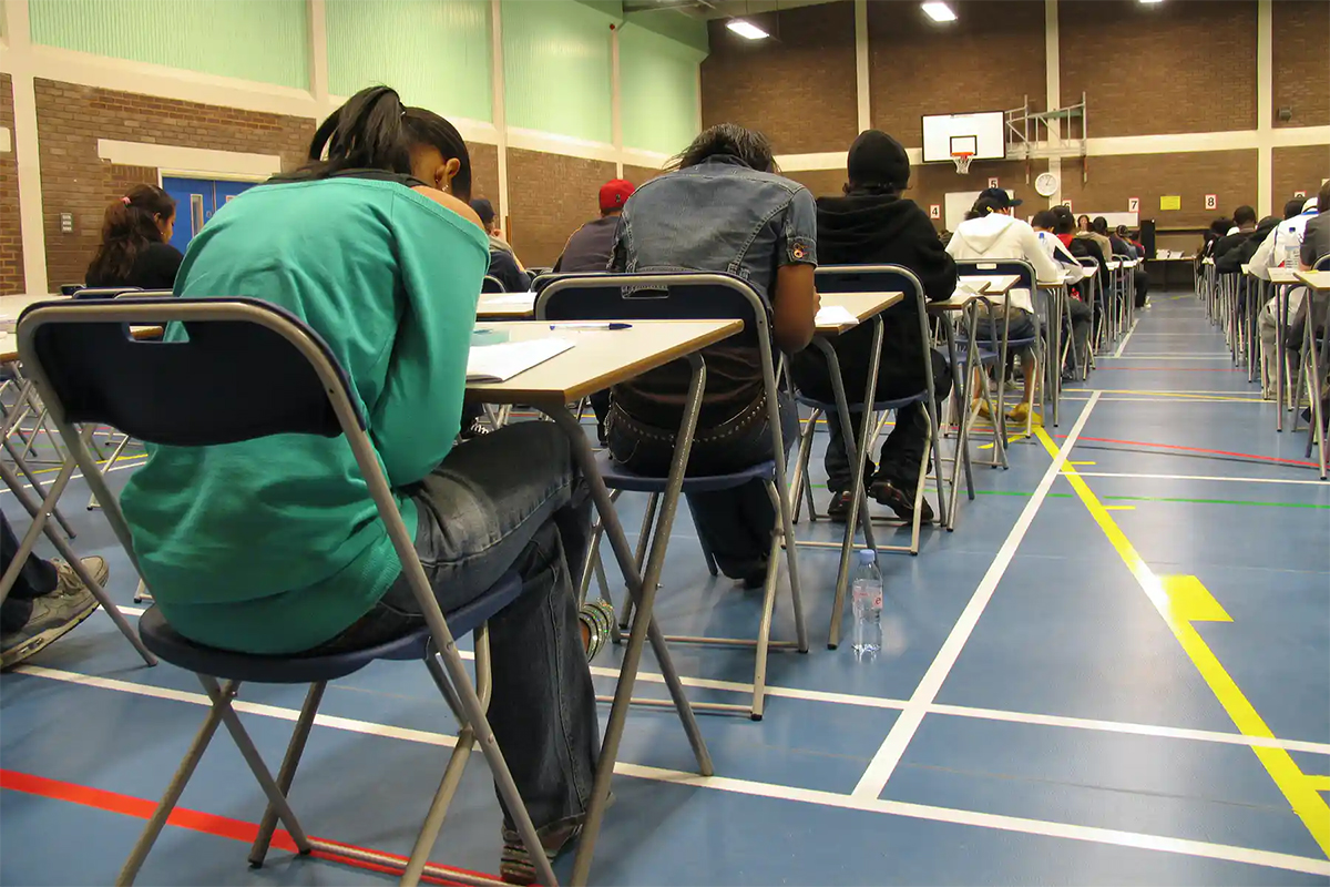 Students writing an exam.