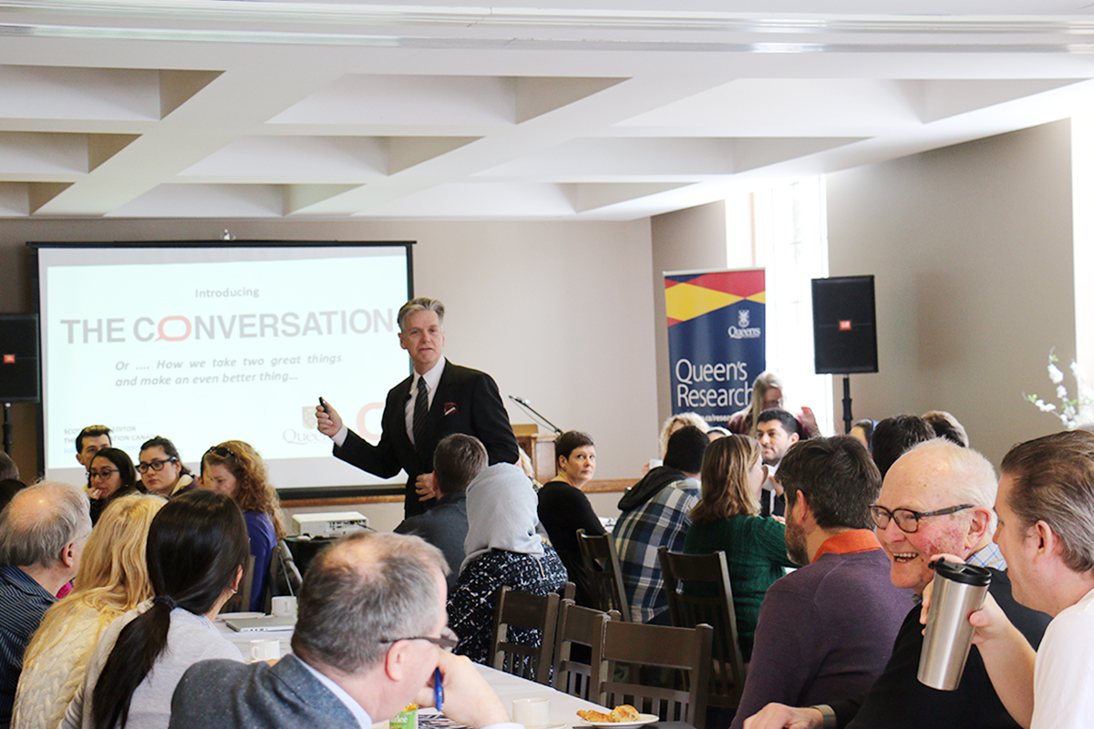 Scott White speaks to Queen's researchers about The Conversation during a workshop in 2019.