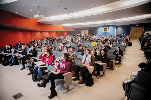 Students attending class in an auditorium.