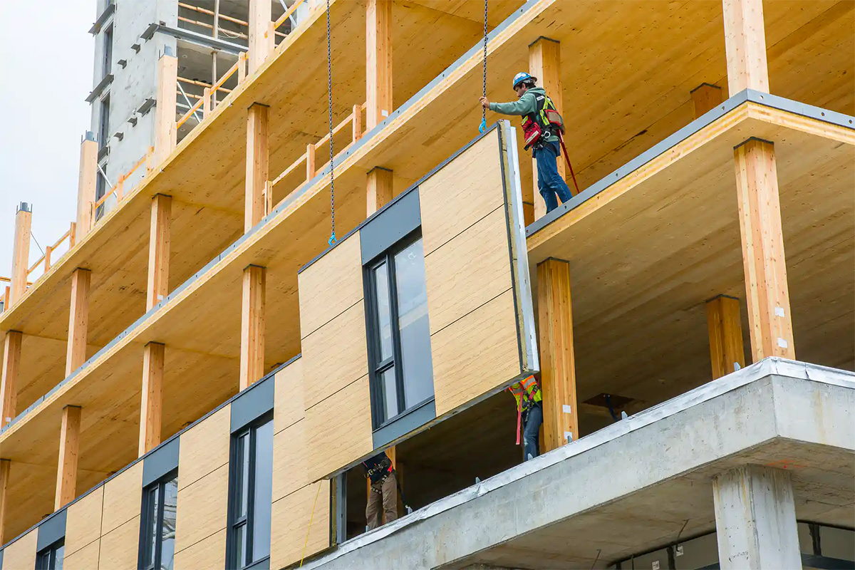 Workers build a Wood skyscraper at UBC