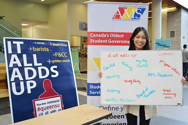 Jenn Li (ConEd'17), President of the Alma Mater Society, visited the It All Adds Up booth at the Athletics and Recreation Centre, and filled up the white board with how her university experience adds up for her. (Photo by Candice Pinto)