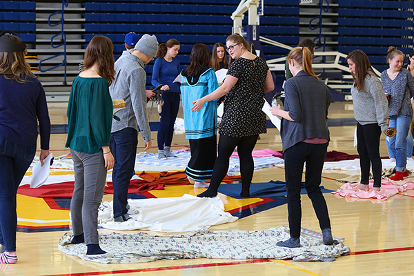"""Students take part in a KAIROS blanket exercise"""