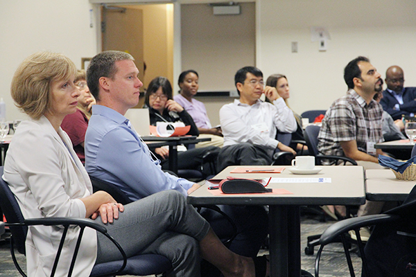 """New faculty at Queen's University listen to presentation during their orientation"""
