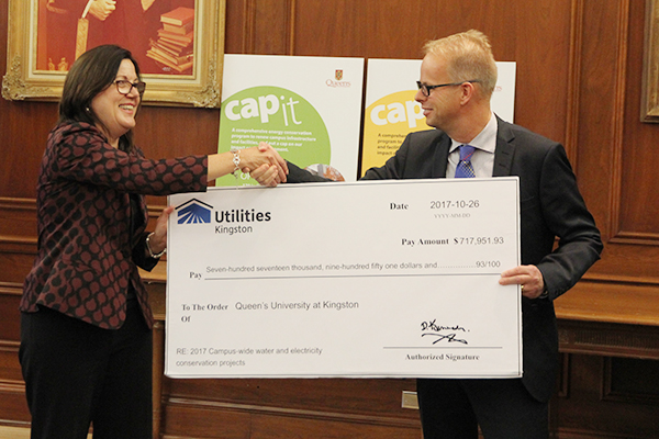 Donna Janiec, Vice-Principal (Finance and Administration) accepts a cheque from Sean Meleschuk, Vice-President of Utilities Kingston.